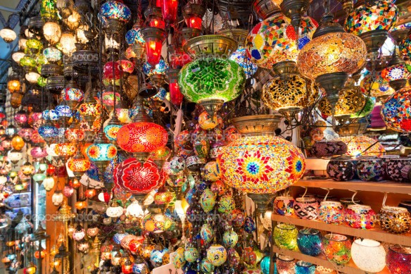 ISTANBUL - MAY 27, 2013: Colorful Turkish lanterns offered for sale at the Grand Bazaar on may 27, 2013 in Istanbul, Turkey. It is a popular souvenir for tourists.
